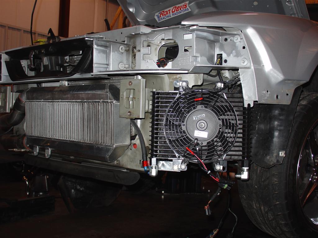 Mounting transmission cooler under car